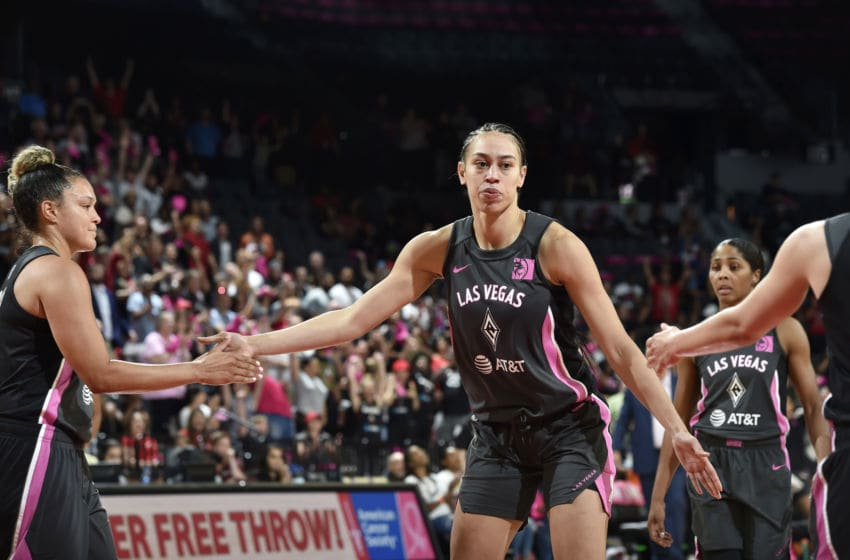 LAS VEGAS, NV - AUGUST 20: Dearica Hamby #5 of the Las Vegas Aces hi-fives teammates during the game against the Phoenix Mercury on August 20, 2019 at the Mandalay Bay Events Center in Las Vegas, Nevada. NOTE TO USER: User expressly acknowledges and agrees that, by downloading and or using this photograph, User is consenting to the terms and conditions of the Getty Images License Agreement. Mandatory Copyright Notice: Copyright 2019 NBAE (Photo by David Becker/NBAE via Getty Images)