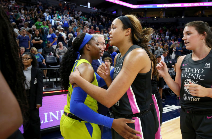MINNEAPOLIS, MN - AUGUST 22: Arike Ogunbowale #24 of Dallas Wings hugs Napheesa Collier #24 of the Minnesota Lynx after the game between the two teams on August 22, 2019 at the Target Center in Minneapolis, Minneosta. NOTE TO USER: User expressly acknowledges and agrees that, by downloading and or using this photograph, User is consenting to the terms and conditions of the Getty Images License Agreement. Mandatory Copyright Notice: Copyright 2019 NBAE (Photo by David Sherman/NBAE via Getty Images)