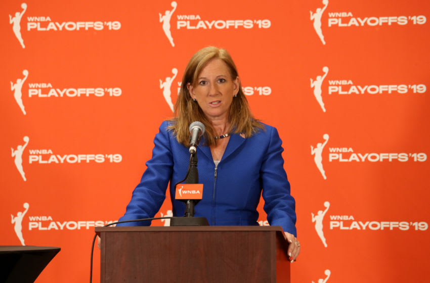 CHICAGO, IL - SEPTEMBER 11: WNBA Commissioner Cathy Engelbert presents the WNBA Coach of the Year Award to Head Coach James Wade of the Chicago Sky before the game against the Phoenix Mercury during Round One of the WNBA Playoffs on September 11, 2019 at Wintrust Arena in Chicago, Illinois. NOTE TO USER: User expressly acknowledges and agrees that, by downloading and/or using this photograph, user is consenting to the terms and conditions of the Getty Images License Agreement. Mandatory Copyright Notice: Copyright 2019 NBAE (Photo by Gary Dineen/NBAE via Getty Images)