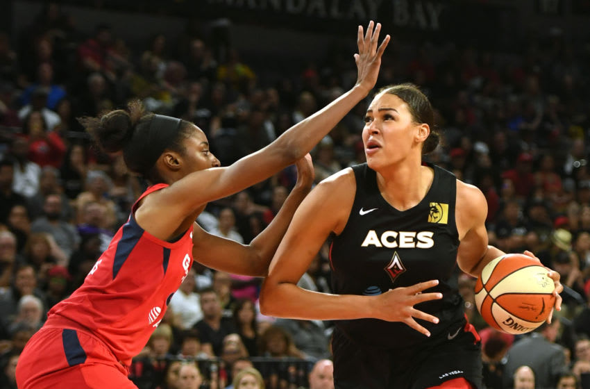 LAS VEGAS, NEVADA - SEPTEMBER 22: Liz Cambage #8 of the Las Vegas Aces drives against LaToya Sanders #30 of the Washington Mystics during Game Three of the 2019 WNBA Playoff semifinals at the Mandalay Bay Events Center on September 22, 2019 in Las Vegas, Nevada. The Aces defeated the Mystics 92-75. NOTE TO USER: User expressly acknowledges and agrees that, by downloading and or using this photograph, User is consenting to the terms and conditions of the Getty Images License Agreement. (Photo by Ethan Miller/Getty Images)