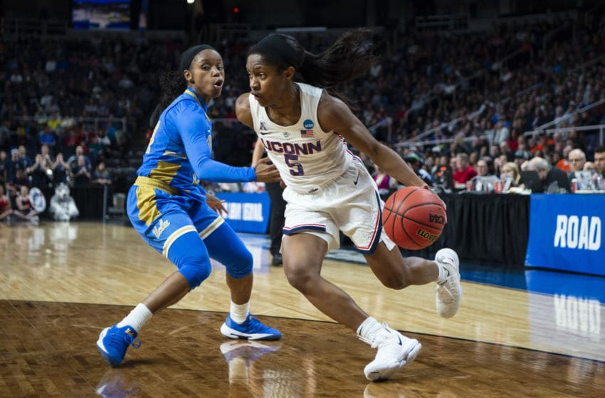 ALBANY, NY - MARCH 29: Connecticut Huskies Guard Crystal Dangerfield (5) dribbles the ball past UCLA Bruins Guard Japreece Dean (24) defending during the first half of the game between the UCLA Bruins and the University of Connecticut Huskies on March 29, 2019, at the Times Union Center in Albany NY. (Photo by Gregory Fisher/Icon Sportswire via Getty Images)