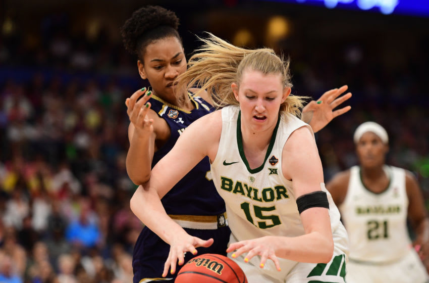 TAMPA, FL - APRIL 07: Lauren Cox #15 of the Baylor Bears grabs a rebound away from Mikayla Vaughn #30 of the Notre Dame Fighting Irish at Amalie Arena on April 7, 2019 in Tampa, Florida. (Photo by Justin Tafoya/NCAA Photos via Getty Images)