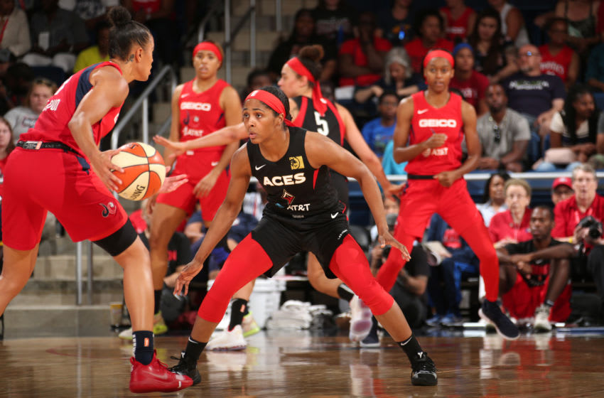 WASHINGTON, DC - JULY 13: Sydney Colson #51 of the Las Vegas Aces plays defense against Natasha Cloud #9 of the Washington Mystics on July 13, 2019 at the St. Elizabeths East Entertainment and Sports Arena in Washington, DC. NOTE TO USER: User expressly acknowledges and agrees that, by downloading and or using this photograph, User is consenting to the terms and conditions of the Getty Images License Agreement. Mandatory Copyright Notice: Copyright 2019 NBAE (Photo by Ned Dishman/NBAE via Getty Images)
