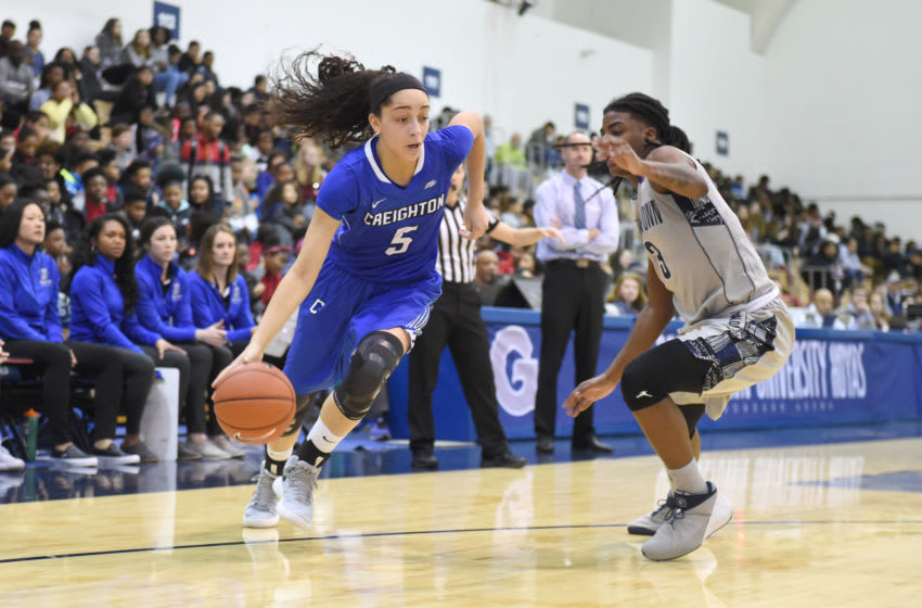 WASHINGTON, DC - FEBRUARY 23: Jaylyn Agnew #5 of the Creighton Bluejays dribbles by Morgan Smith #3 of the Georgetown Hoyas during a woman's college basketball game at McDonough Arena on February 23, 2018 in Washington, DC. The Hoyas won 70-67. Photo by Mitchell Layton/Getty Images)