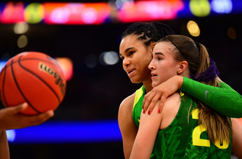 TAMPA, FL - APRIL 05: Satou Sabally #0 and Sabrina Ionescu #20 of the Oregon Ducks hug during their game against the Baylor Bears at Amalie Arena on April 5, 2019 in Tampa, Florida. (Photo by Ben Solomon/NCAA Photos via Getty Images)