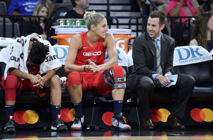 LAS VEGAS, NV - JUNE 20: Elena Delle Donne #11 of the Washington Mystics talks to assistant coach Eric Thibault during the game against the Las Vegas Aces on June 20, 2019 at the Mandalay Bay Events Center in Las Vegas, Nevada. NOTE TO USER: User expressly acknowledges and agrees that, by downloading and or using this photograph, User is consenting to the terms and conditions of the Getty Images License Agreement. Mandatory Copyright Notice: Copyright 2019 NBAE (Photo by Jeff Bottari/NBAE via Getty Images)