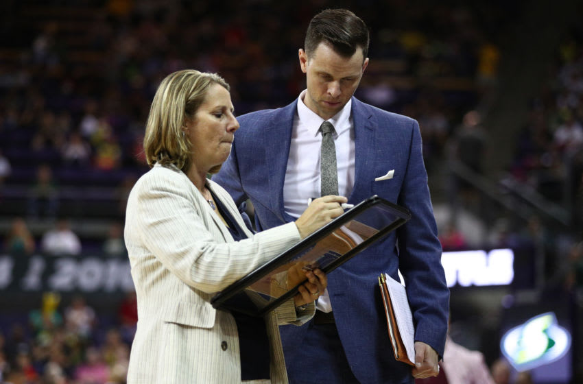 SEATTLE, WASHINGTON - AUGUST 18: Minnesota Lynx Head Coach Cheryl Reeve and assistant coach Walt Hopkins discuss play in the third quarter against the Seattle Storm during their game at Alaska Airlines Arena on August 18, 2019 in Seattle, Washington. NOTE TO USER: User expressly acknowledges and agrees that, by downloading and/or using this photograph, user is consenting to the terms and conditions of the Getty Images License Agreement. Mandatory Copyright Notice: Copyright 2019 NBAE (Photo by Abbie Parr/Getty Images)