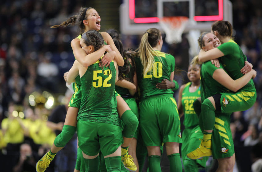 BRIDGEPORT, CONNECTICUT- MARCH 25: Lexi Bando #10 of the Oregon Ducks is held high by team mate Sierra Campisano #52 of the Oregon Ducks as the Oregon Ducks celebrate their victory during the Maryland Terrapins vs. Oregon Ducks, NCAA Division 1 Women's Basketball Championship game on March 25th, 2017 at the Webster Bank Arena, Bridgeport, Connecticut. (Photo by Tim Clayton/Corbis via Getty Images)