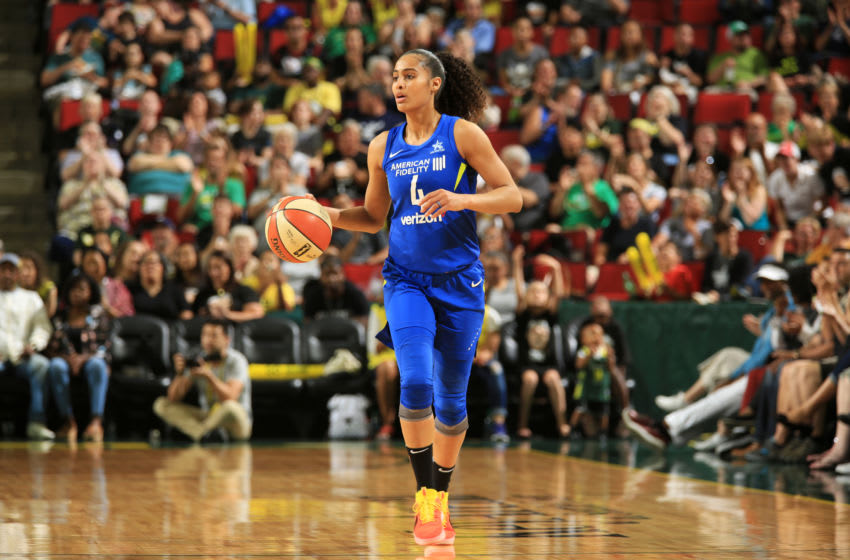 SEATTLE, WA - AUGUST 19: Skylar Diggins-Smith #4 of the Dallas Wings handles the ball against the Seattle Storm on August 19, 2018 at KeyArena in Seattle, Washington. NOTE TO USER: User expressly acknowledges and agrees that, by downloading and/or using this Photograph, user is consenting to the terms and conditions of Getty Images License Agreement. Mandatory Copyright Notice: Copyright 2018 NBAE (Photo by Joshua Huston/NBAE via Getty Images)