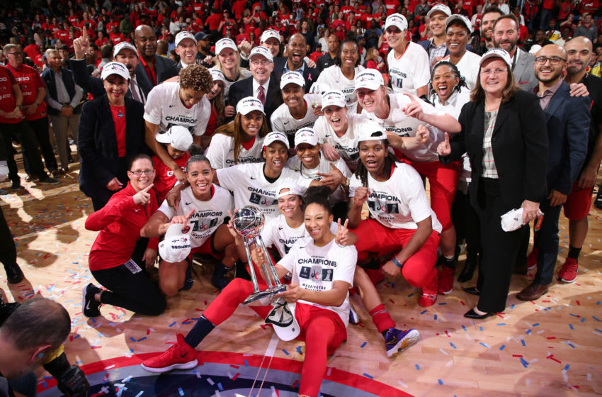 WASHINGTON, DC - OCTOBER 10: The the Washington Mystics pose for a photo with the WNBA Championship Trophy afterGame Five of the 2019 WNBA Finals on October 10, 2019 at St Elizabeths East Entertainment & Sports Arena in Washington, DC. NOTE TO USER: User expressly acknowledges and agrees that, by downloading and or using this Photograph, user is consenting to the terms and conditions of the Getty Images License Agreement. Mandatory Copyright Notice: Copyright 2019 NBAE (Photo by Ned Dishman/NBAE via Getty Images)