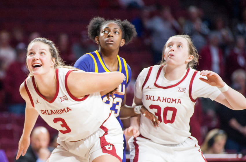 NORMAN, OK - DECEMBER 07: Oklahoma (3) Mandy Simpson and (30) Taylor Robertson blocking out Louisiana State (23) Karli Seay on December 07, 2019, at the Lloyd Noble Center in Norman, Oklahoma. (Photo by Torrey Purvey/Icon Sportswire via Getty Images)
