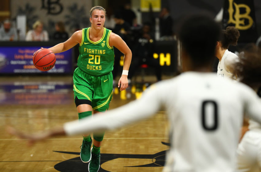 LONG BEACH, CALIFORNIA - DECEMBER 14: Sabrina Ionescu #20 of the Oregon Ducks moves the ball up the court in the fourth quarter against Long Beach State at Walter Pyramid on December 14, 2019 in Long Beach, California. (Photo by Joe Scarnici/Getty Images)