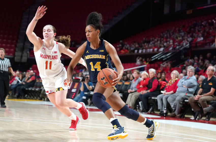 COLLEGE PARK, MD - DECEMBER 28: Akienreh Johnson #14 of the Michigan Wolverines dribbles by Taylor Mikesell #11 of the Maryland Terrapins during a women's college basketball game at the Xfinity Center on December 28, 2019 in College Park, Maryland. (Photo by Mitchell Layton/Getty Images)