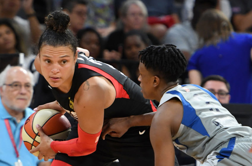 LAS VEGAS, NEVADA - JULY 21: Kayla McBride #21 of the Las Vegas Aces is guarded by Danielle Robinson #3 of the Minnesota Lynx during their game at the Mandalay Bay Events Center on July 21, 2019 in Las Vegas, Nevada. The Aces defeated the Lynx 79-74. NOTE TO USER: User expressly acknowledges and agrees that, by downloading and or using this photograph, User is consenting to the terms and conditions of the Getty Images License Agreement. (Photo by Ethan Miller/Getty Images)