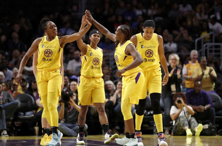 LOS ANGELES, CALIFORNIA - AUGUST 08: Forward Nneka Ogwumike #30, guard Tierra Ruffin-Pratt #10, and guard Chelsea Gray #12 of the Los Angeles Sparks high-five after a basket against the Phoenix Mercury at Staples Center on August 08, 2019 in Los Angeles, California. NOTE TO USER: User expressly acknowledges and agrees that, by downloading and or using this photograph, User is consenting to the terms and conditions of the Getty Images License Agreement. (Photo by Meg Oliphant/Getty Images)