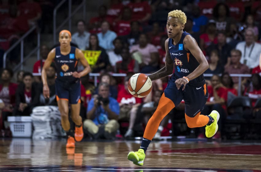 WASHINGTON, DC - OCTOBER 01: Courtney Williams #10 of the Connecticut Sun handles the ball against the Washington Mystics during the first half of Game Two of the 2019 WNBA finals at St Elizabeths East Entertainment & Sports Arena on October 1, 2019 in Washington, DC. NOTE TO USER: User expressly acknowledges and agrees that, by downloading and or using this photograph, User is consenting to the terms and conditions of the Getty Images License Agreement. (Photo by Scott Taetsch/Getty Images)