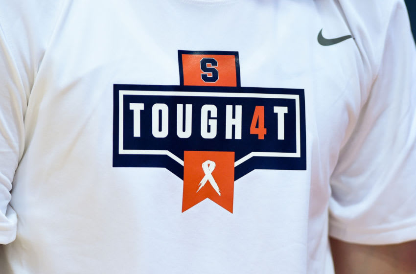 SYRACUSE, NY - NOVEMBER 06: Detailed view of a shirt worn by the Syracuse Orange players to honor Women's basketball player Tiana Mangakahia prior to the game against the Virginia Cavaliers at the Carrier Dome on November 6, 2019 in Syracuse, New York. After surgery and five months of chemotherapy for breast cancer, Mangakahia was announced to be cancer free. Virginia defeated Syracuse 48-34. (Photo by Rich Barnes/Getty Images)