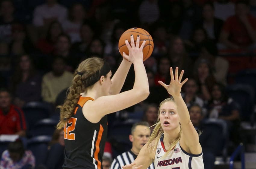 TUCSON, AZ - JANUARY 10: Arizona Wildcats forward Cate Reese (25) guards Oregon State Beavers forward Kennedy Brown (42) during a college women's basketball game between the Oregon State Beavers and the Arizona Wildcats on January 10, 2019, at McKale Center in Tucson, AZ.