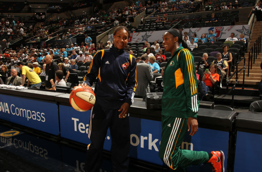 SAN ANTONIO, TX - JULY 23: Swin Cash #2 of the Western Conference All-Stars talks to Tamika Catchings #24 of the Eastern Conference All-Stars at AT&T Center on July 23, 2011 in San Antonio, Texas. NOTE TO USER: User expressly acknowledges and agrees that, by downloading and or using this photograph, user is consenting to the terms and conditions of the Getty Images License Agreement. Mandatory Copyright Notice: Copyright 2011 NBAE (Photos by Chris Covatta/NBAE via Getty Images)