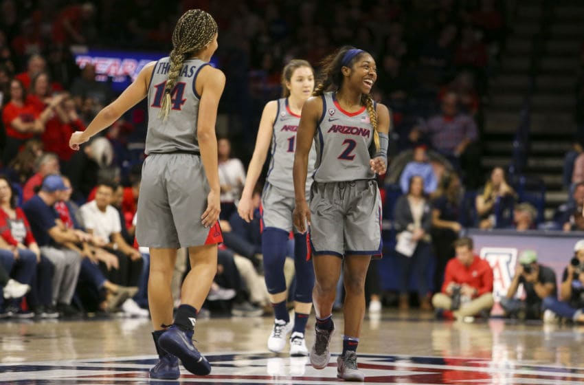 TUCSON, AZ - JANUARY 31: Arizona Wildcats guard Aarion McDonald (2) laughs with her teammates after missing a shot during a college women's basketball game between the UCLA Bruins and the Arizona Wildcats on January 31, 2020, at McKale Center in Tucson, AZ. (Photo by Jacob Snow/Icon Sportswire via Getty Images)