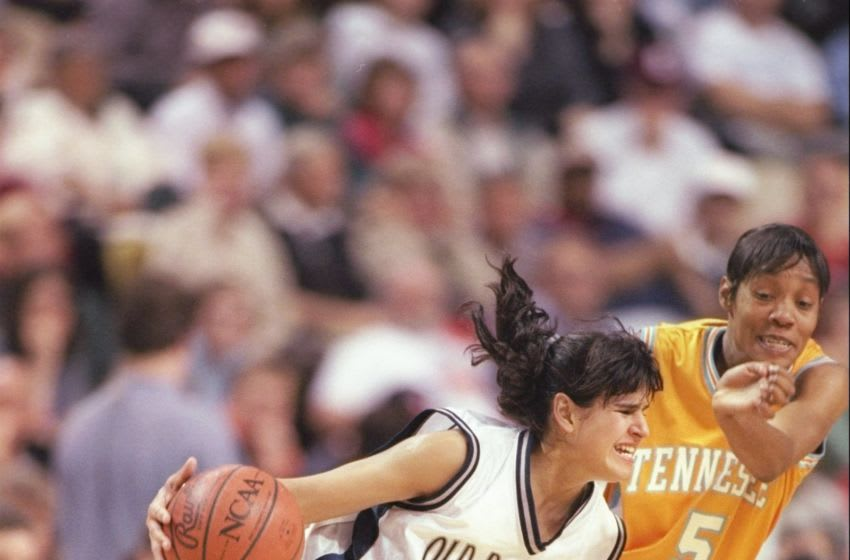 30 Mar 1997: Ticha Penicheiro of the Old Dominion Monoarchs dribbles past Kyra Elzy of the Tennessee Volunteers at Riverfront Coliseum in Cincinnati, Ohio. The Volunteers won the game 68 - 59.