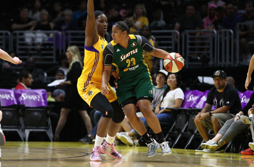 LOS ANGELES, CA - AUGUST 11: Kaleena Mosqueda-Lewis #23 of the Seattle Storm handles the ball against Jantel Lavender #42 of the Los Angeles Sparks in a WNBA game at Staples Center on August 11, 2015 in Los Angeles, California. (Photo by Leon Bennett/Getty Images)