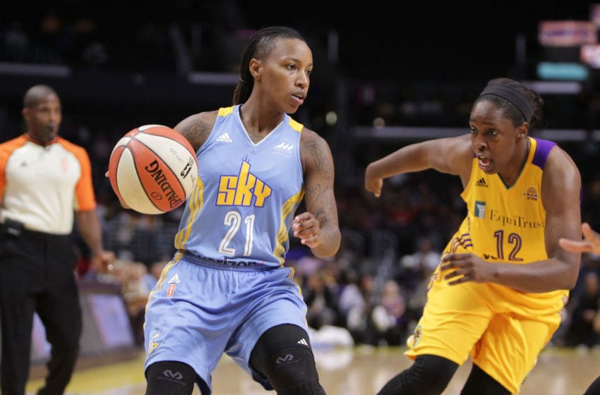 LOS ANGELES, CA - SEPTEMBER 30: Jamierra Faulkner #21 of the Los Angeles Sparks dribbles the ball against Chelsea Gray #12 of the Chicago Sky in Game Two of the Semifinals during the 2016 WNBA Playoffs at Staples Center on September 30, 2016 in Los Angeles, California. (Photo by Leon Bennett/Getty Images)