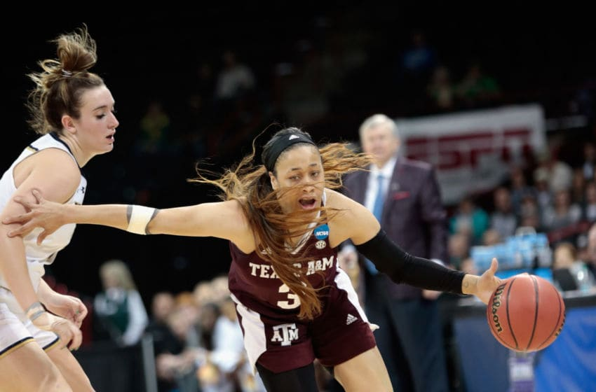 SPOKANE, WA - MARCH 24: Chennedy Carter #3 of the Texas A&M Aggies drives against Marina Mabrey #3 of the Notre Dame Fighting Irish during the 2018 NCAA Division 1 Women's Basketball Tournament at Spokane Veterans Memorial Arena on March 24, 2018 in Spokane, Washington. (Photo by William Mancebo/Getty Images)