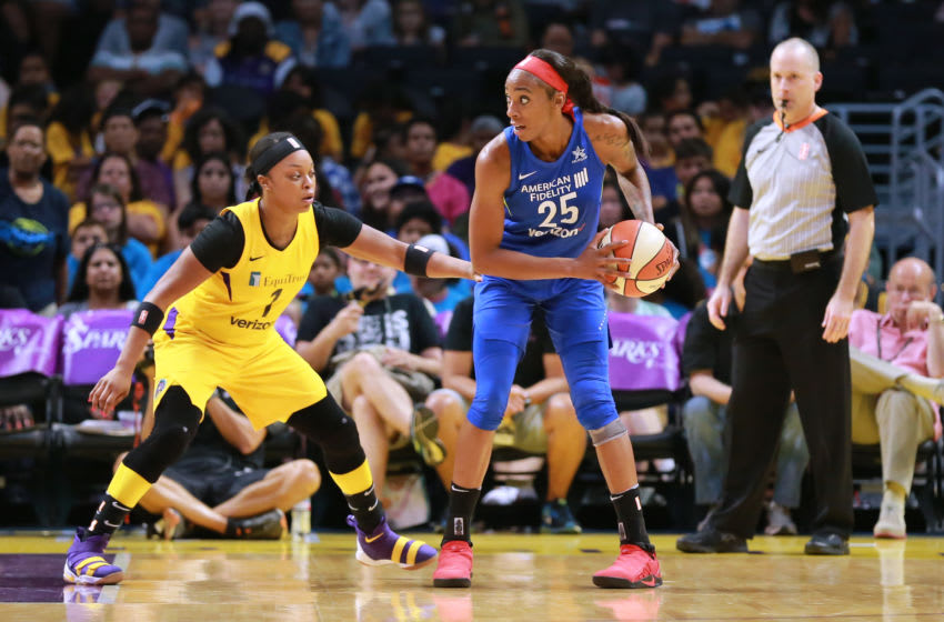 LOS ANGELES, CA - JULY 12: Glory Johnson #25 of the Dallas Wings handles the ball against Odyssey Sims #1 of the Los Angeles Sparks during a WNBA basketball game at Staples Center on July 12, 2018 in Los Angeles, California. (Photo by Leon Bennett/Getty Images)
