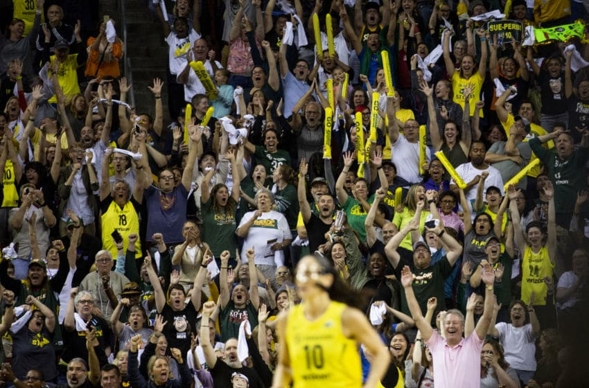 SEATTLE, WA - SEPTEMBER 09: Seattle Storm fans erupt after Sue Bird #10 of the Seattle Storm hit a three-pointer from over 30 feet away against the Washington Mystics during the second half of Game 2 of the WNBA Finals at KeyArena on September 9, 2018 in Seattle, Washington. The Seattle Storm beat the Washington Mystics 75-73. (Photo by Lindsey Wasson/Getty Images)