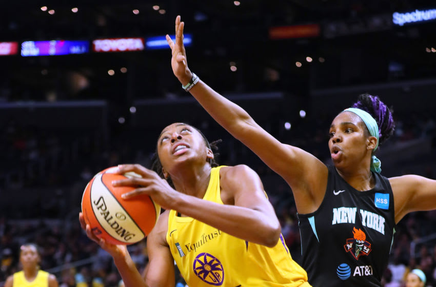 LOS ANGELES, CALIFORNIA - JUNE 15: Nneka Ogwumike #30 of the Los Angeles Sparks handles the ball against Reshanda Gray #12 of the New York Liberty during a WNBA basketball game at Staples Center on June 15, 2019 in Los Angeles, California. (Photo by Leon Bennett/Getty Images)