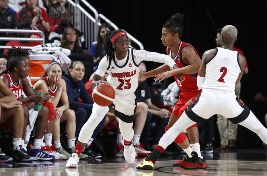 LOUISVILLE, KY - FEBRUARY 02: Jazmine Jones #23 of the Louisville Cardinals handles the basketball during an exhibition game against the USA Women's National team at KFC YUM! Center on February 2, 2020 in Louisville, Kentucky. (Photo by Joe Robbins/Getty Images)