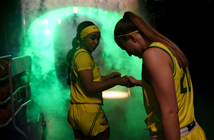 LAS VEGAS, NEVADA - MARCH 07: Minyon Moore (L) #23 of the Oregon Ducks and her teammate Sabrina Ionescu #20 wait to be introduced before a semifinal game of the Pac-12 Conference women's basketball tournament against the Arizona Wildcats at the Mandalay Bay Events Center on March 7, 2020 in Las Vegas, Nevada. The Ducks defeated the Wildcats 88-70. (Photo by Ethan Miller/Getty Images)