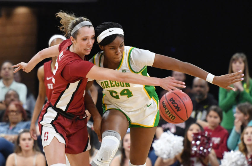 LAS VEGAS, NEVADA - MARCH 08: Lexie Hull #12 of the Stanford Cardinal knocks the ball away from Ruthy Hebard #24 of the Oregon Ducks during the championship game of the Pac-12 Conference women's basketball tournament at the Mandalay Bay Events Center on March 8, 2020 in Las Vegas, Nevada. (Photo by Ethan Miller/Getty Images)