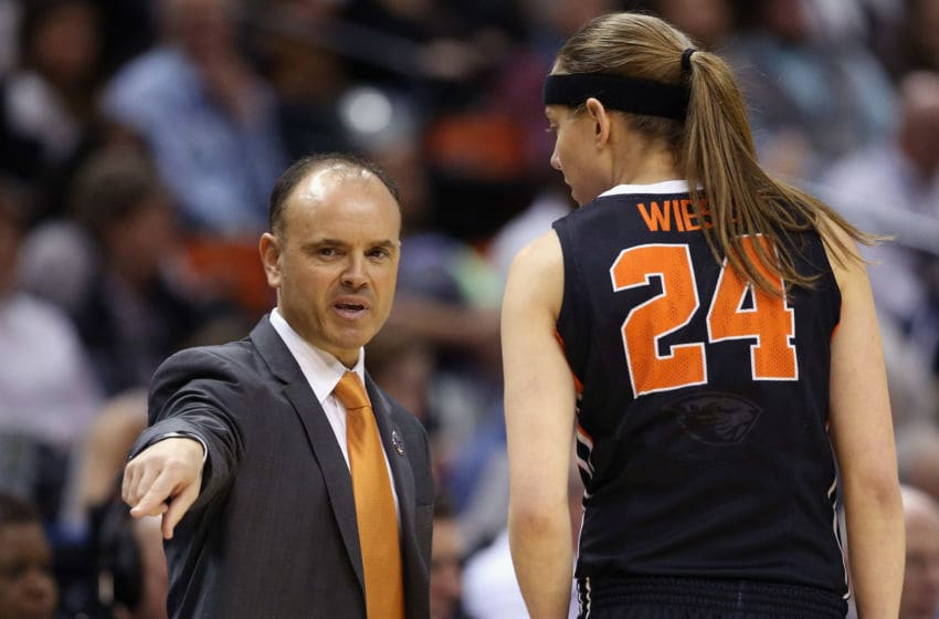 INDIANAPOLIS, IN - APRIL 03: Head coach Scott Rueck of the Oregon State Beavers talks with Sydney Wiese #24 in the first half against the Connecticut Huskies during the semifinals of the 2016 NCAA Women's Final Four Basketball Championship at Bankers Life Fieldhouse on April 3, 2016 in Indianapolis, Indiana. (Photo by Andy Lyons/Getty Images)