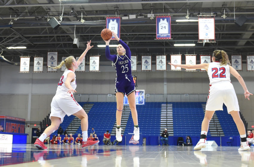 WASHINGTON, DC - JANUARY 30: Lauren Manis #25 passes the ball of the Holy Cross Crusaders takes a shot during a women's college basketball game against the American Eagles at Bender Arena on January 30, 2019 in Washington, DC. (Photo by Mitchell Layton/Getty Images)