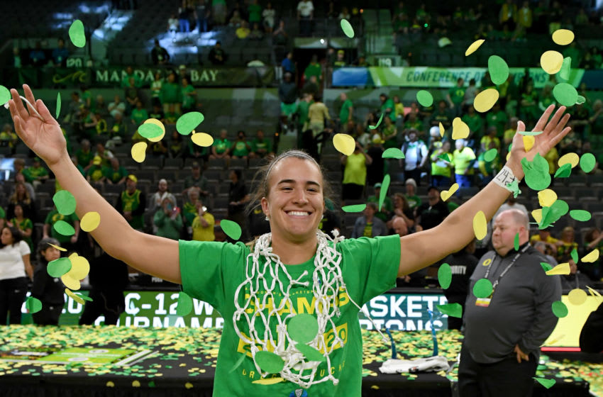 LAS VEGAS, NEVADA - MARCH 08: Sabrina Ionescu #20 of the Oregon Ducks wears a basketball net around her neck and throws confetti in the air as she celebrates her team's 89-56 win over the Stanford Cardinal to win the championship game of the Pac-12 Conference women's basketball tournament at the Mandalay Bay Events Center on March 8, 2020 in Las Vegas, Nevada. (Photo by Ethan Miller/Getty Images)
