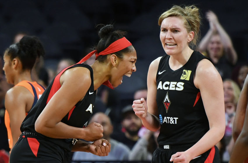 LAS VEGAS, NEVADA - JUNE 02: A'ja Wilson (L) #22 and Carolyn Swords #4 of the Las Vegas Aces react after Wilson made a shot and was fouled during their game against the Connecticut Sun at the Mandalay Bay Events Center on June 2, 2019 in Las Vegas, Nevada. NOTE TO USER: User expressly acknowledges and agrees that, by downloading and or using this photograph, User is consenting to the terms and conditions of the Getty Images License Agreement. (Photo by Ethan Miller/Getty Images )
