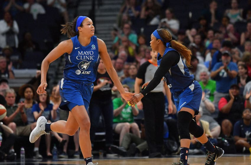 MINNEAPOLIS, MINNESOTA - JUNE 08: Napheesa Collier #24 exchanges a low five with Odyssey Sims #1 of the Minnesota Lynx during their game against the Los Angeles Sparks at Target Center on June 08, 2019 in Minneapolis, Minnesota. The Sparks defeated the Lynx 89-85. NOTE TO USER: User expressly acknowledges and agrees that, by downloading and or using this photograph, User is consenting to the terms and conditions of the Getty Images License Agreement. (Photo by Sam Wasson/Getty Images)