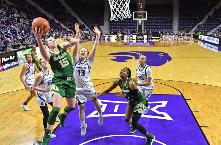 MANHATTAN, KS - FEBRUARY 13: Lauren Cox #15 of the Baylor Bears drives in for a basket past Laura Macke #13 of the Kansas State Wildcats during the second half on February 13, 2019 at Bramlage Coliseum in Manhattan, Kansas. (Photo by Peter G. Aiken/Getty Images)