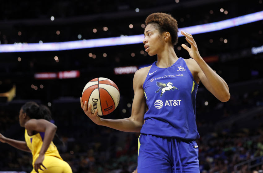 LOS ANGELES, CALIFORNIA - JULY 18: Forward Isabelle Harrison #20 of the Dallas Wings looks to pass the ball in the game against the Los Angeles Sparks at Staples Center on July 18, 2019 in Los Angeles, California. NOTE TO USER: User expressly acknowledges and agrees that, by downloading and or using this photograph, User is consenting to the terms and conditions of the Getty Images License Agreement. (Photo by Meg Oliphant/Getty Images)
