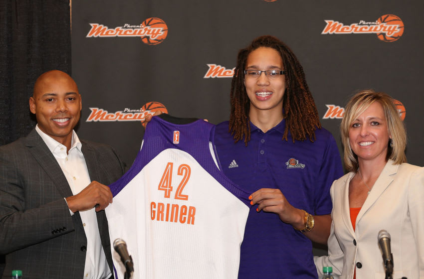 PHOENIX, AZ - APRIL 20: Brittney Griner (C) of the Phoenix Mercury poses with head coach Corey Gaines (L) and President/COO Amber Cox (R) during a press conference after being selected as the first pick in the 2013 WNBA Draft at US Airways Center on April 20, 2013 in Phoenix, Arizona. NOTE TO USER: User expressly acknowledges and agrees that, by downloading and or using this photograph, User is consenting to the terms and conditions of the Getty Images License Agreement. (Photo by Christian Petersen/Getty Images)