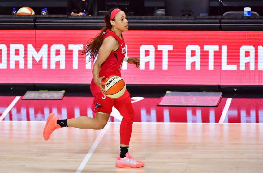 PALMETTO, FLORIDA - JULY 29: Chennedy Carter #3 of the Atlanta Dream dribbles across the court during the first half of a game against the Las Vegas Aces at Feld Entertainment Center on July 29, 2020 in Palmetto, Florida. (Photo by Julio Aguilar/Getty Images)