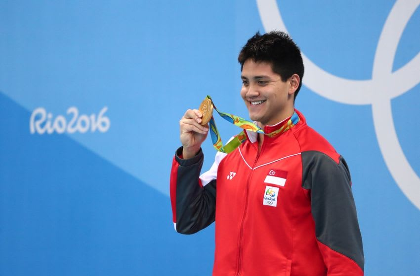Aug 12, 2016; Rio de Janeiro, Brazil; Joseph Schooling (SIN) with his gold medal after the men