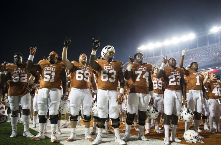 AUSTIN, TX - OCTOBER 15: The Texas Longhorns celebrate after defeating the Iowa State Cyclones 27-6 on October 15, 2016 at Darrell K Royal-Texas Memorial Stadium in Austin, Texas. (Photo by Cooper Neill/Getty Images)
