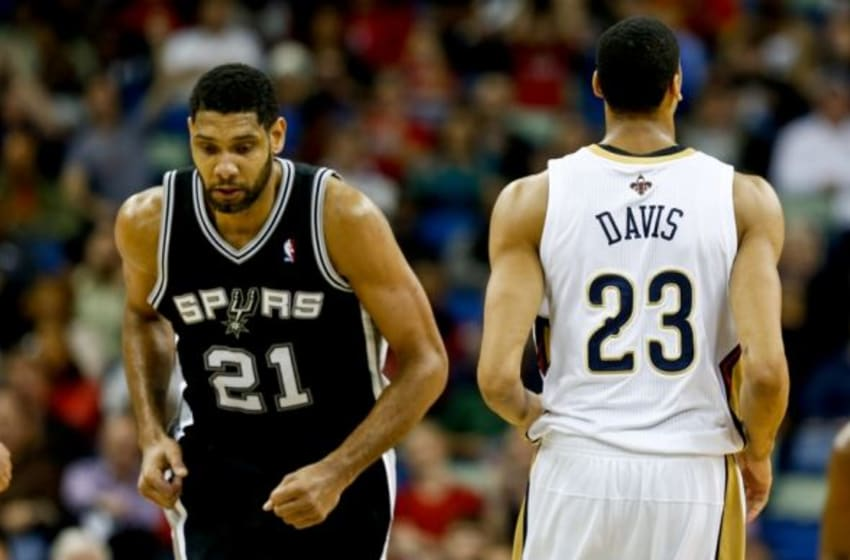 Jan 13, 2014; New Orleans, LA, USA; New Orleans Pelicans power forward Anthony Davis (23) and San Antonio Spurs power forward Tim Duncan (21) during the second quarter of a game at the New Orleans Arena. Mandatory Credit: Derick E. Hingle-USA TODAY Sports