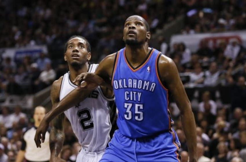 May 29, 2014; San Antonio, TX, USA; Oklahoma City Thunder forward Kevin Durant (35) and San Antonio Spurs forward Kawhi Leonard (2) look for a rebound during the second half in game five of the Western Conference Finals of the 2014 NBA Playoffs at AT&T Center. Mandatory Credit: Soobum Im-USA TODAY Sports