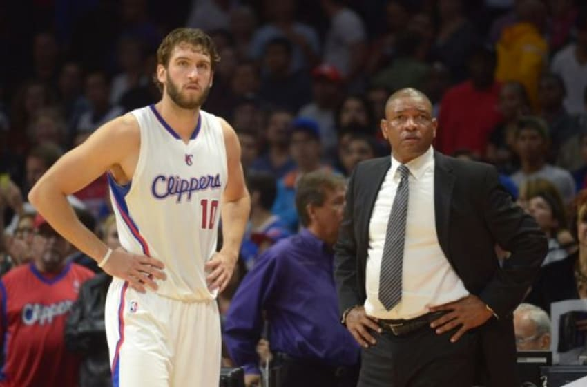 Oct 17, 2014; Los Angeles, CA, USA; Los Angeles Clippers coach Doc Rivers (right) and forward Spencer Hawes (10) react in the fourth quarter against the Utah Jazz at Staples Center. The Clippers defeated the Jazz 101-97. Mandatory Credit: Kirby Lee-USA TODAY Sports