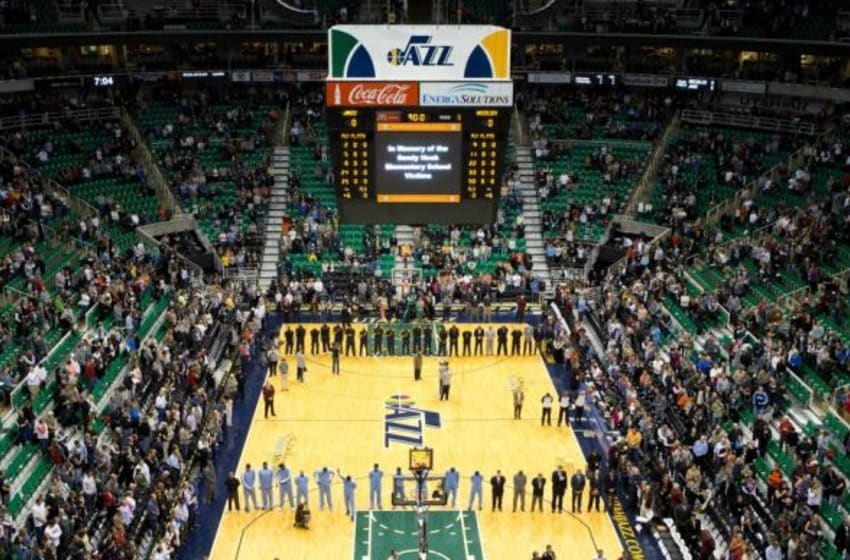 Dec 15, 2012; Salt Lake City, UT, USA; Players, coaches and fans observe a moment of silence to honor the victims of the Sandy Hook Elementary School shooting prior to a game between the Utah Jazz and the Memphis Grizzlies at EnergySolutions Arena. Mandatory Credit: Russ Isabella-USA TODAY Sports