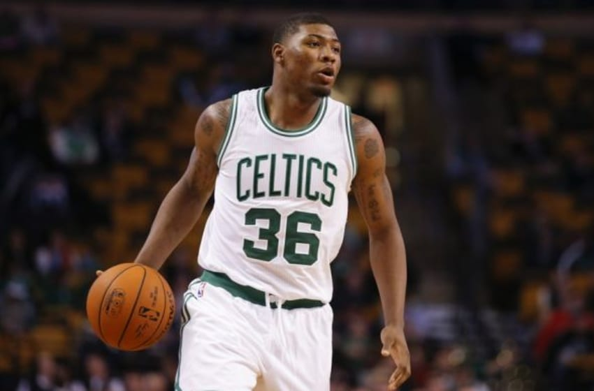Oct 6, 2014; Boston, MA, USA; Boston Celtics guard Marcus Smart (36) works the ball against the Philadelphia 76ers in the second half at TD Garden. Boston defeated the 76ers 98-78. Mandatory Credit: David Butler II-USA TODAY Sports